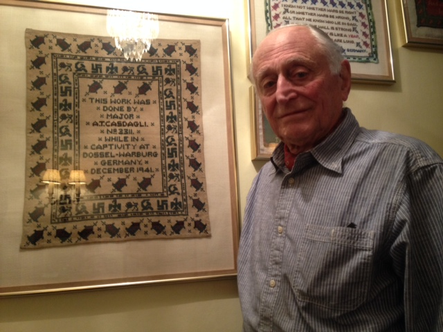 Tony Casdagli with his father's sampler insulting Hitler in morse code